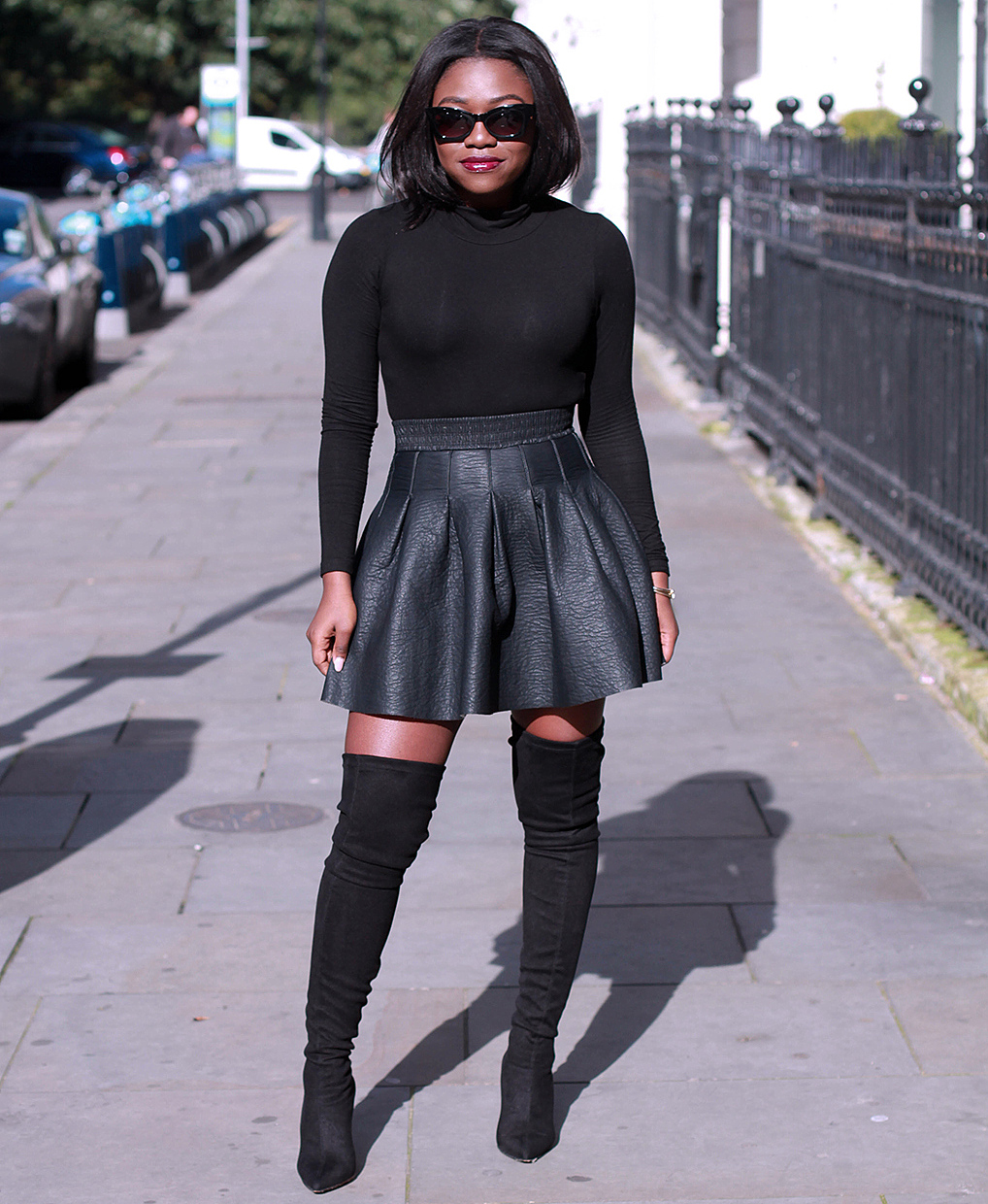 black flared leather skirt suede black thigh high boots