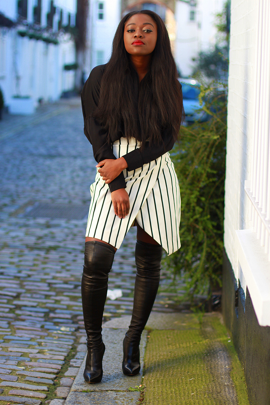 slit skirt and thigh high boots